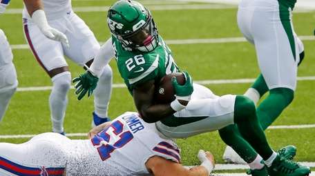 Jets running back Le'Veon Bell is brought down