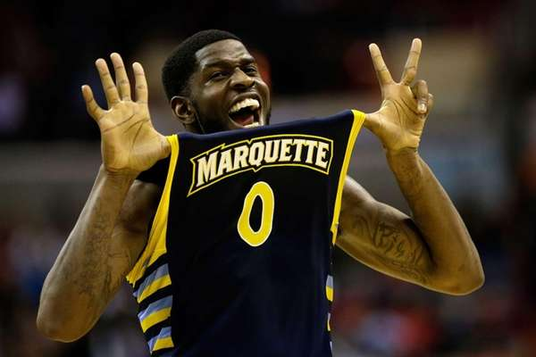 Marquette's Jamil Wilson reacts after defeating Miami during