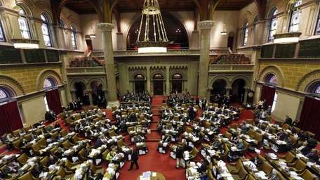 Assembly members debate budget bills in the Assembly