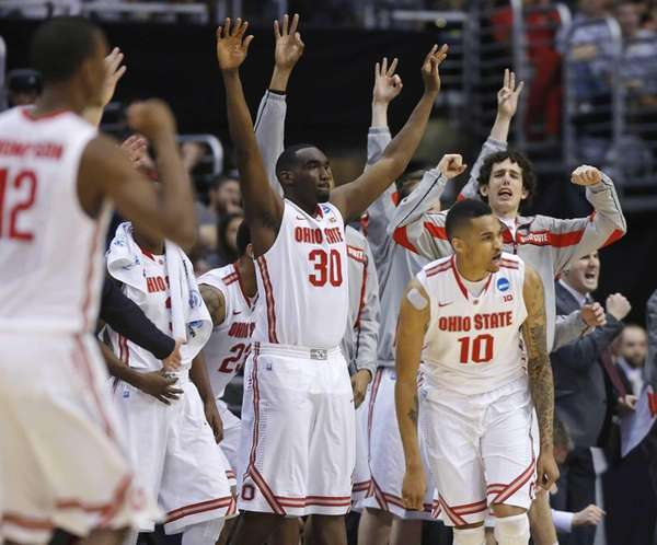 Ohio State players celebrate a 3-point shot against