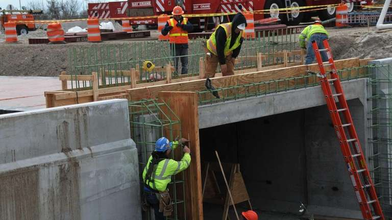 Construction workers rebuild the aging pedestrian tunnel that