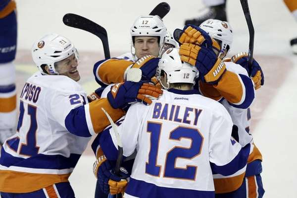 Islanders' Josh Bailey (12) celebrates with Kyle Okposo