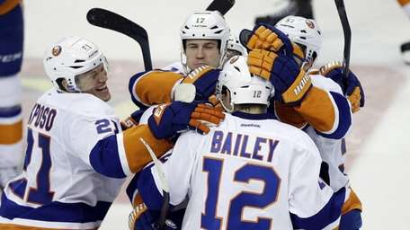 Islanders' Josh Bailey (12) celebrates with Kyle Okposo