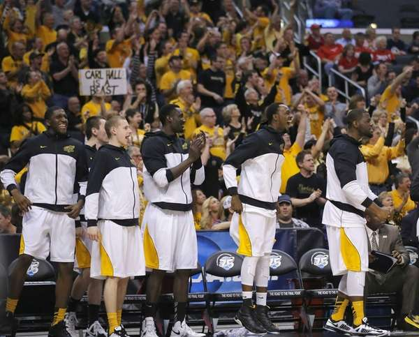 Wichita State players smile and applaud after their