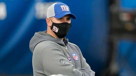 Giants head coach Joe Judge looks on before