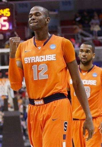 Syracuse center Baye Keita (12) celebrates during the