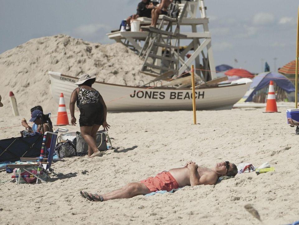 People enjoy the beautiful day at Jones Beach