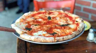 A Margherita pizza with sausage at Molto Pizza