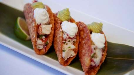 Lobster taco appetizer is prepared at Toku restaurant