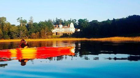 A kayaker on a tour of Stony Brook