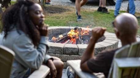 Lounge on Adirondack chairs near the firepit while