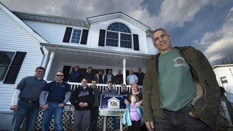 Ed Rowland, foreground, owner of NDA Kitchens &