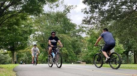 People ride along the bike paths in Eisenhower