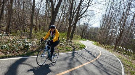 A cyclist rolls along the Port Jefferson Station