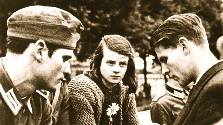 Sophie Scholl, center, with her brother Hans Scholl,