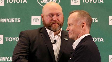 New York Jets general manager Joe Douglas (left)