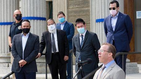 Jewish faith leaders look on as Nassau County