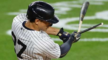 The Yankees' Giancarlo Stanton breaks his bat as