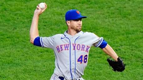 The Mets' Jacob deGrom pitches during the first