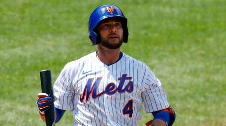 Jed Lowrie of the Mets bats during an