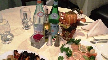Clams casino and chicken limone at Cucina di