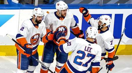 Ryan Pulock #6 of the Islanders is congratulated