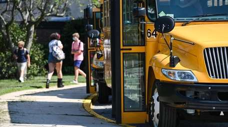 School buses wait in Greenlawn at the end