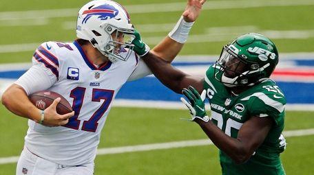 Bills quarterback Josh Allen is pushed out of
