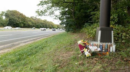 A makeshift memorial lies at the base of