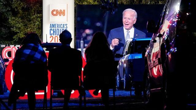Joe Biden is seen on a giant screen