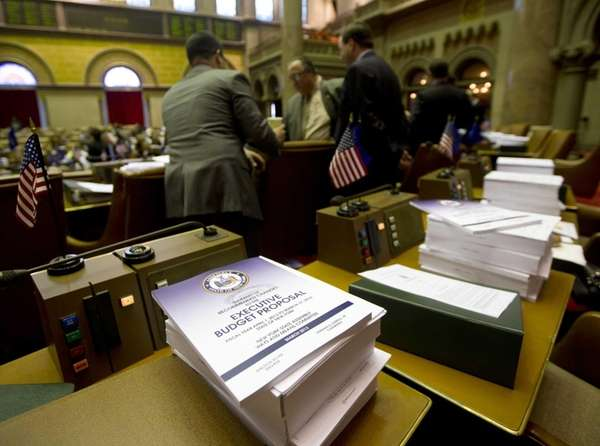 Budget bills sit on a legislator's desk in