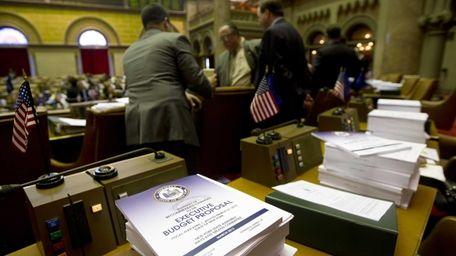Budget bills sit on a legislator's desk in