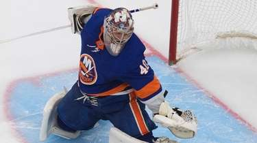 Islanders goaltender Semyon Varlamov makes the save against