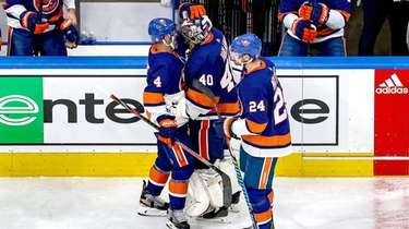 Semyon Varlamov of the Islanders is consoled by