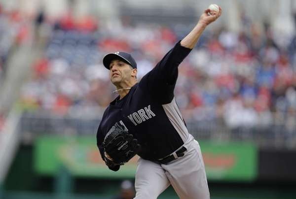 Yankees starting pitcher Andy Pettitte throws during the