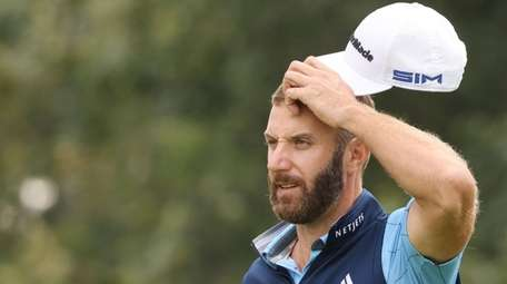 Dustin Johnson  reacts on the third hole