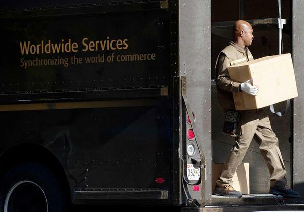 A United Parcel Service delivery man unloads boxes