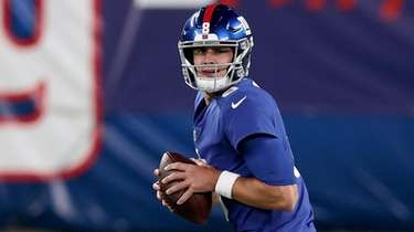 Daniel Jones of the Giants looks to throw