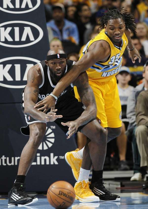 Denver Nuggets forward Kenneth Faried, right, knocks the
