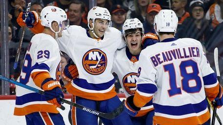 The Islanders' Mathew Barzal (13) celebrates with Anthony