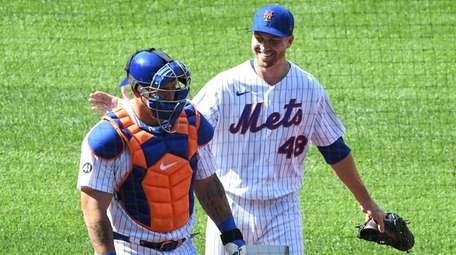 Mets starting pitcher Jacob deGrom smiles as he