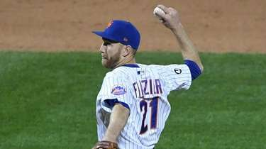 Mets infielder Todd Frazier pitches during the ninth