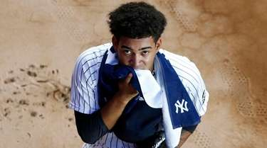 Deivi Garcia of the Yankees warms up in