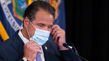 Gov. Andrew M. Cuomo, shown recently adjusting his