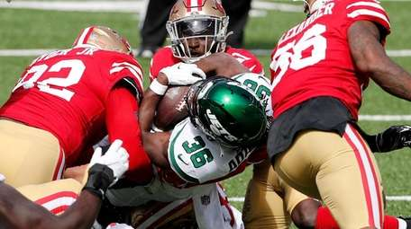 Josh Adams #36 of the Jets is stopped