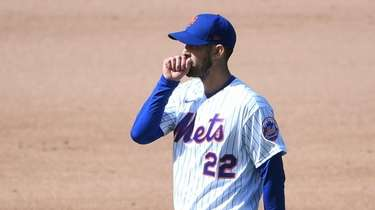 Mets starting pitcher Rick Porcello looks on against