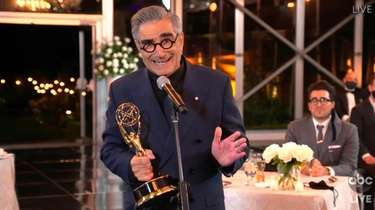 Eugene Levy accepts the outstanding lead actor in