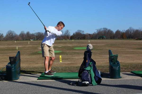 Brian Oleksiak, of Rockville Centre, hits the links