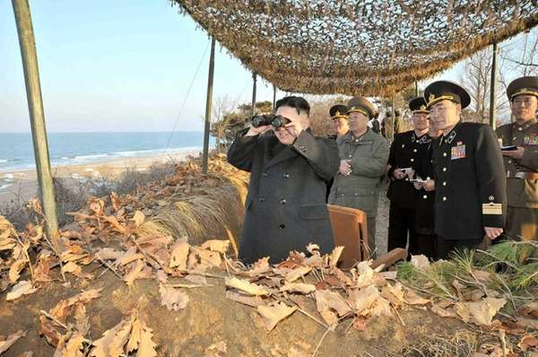 North Korean leader Kim Jong Un, left, inspecting