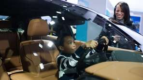 Visitors to the 2013 New York International Auto
